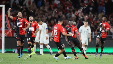 Rennes' M'Baye Niang, third right, celebrates after scoring his side's first goal during the French League One soccer match between Rennes and Paris Saint Germain, in Rennes