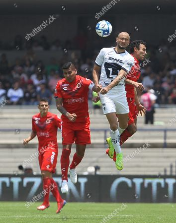 Veracruz Carlos Salcido (2-L) vies for the ball with Pumas' Carlos Gonzalez (2-R), during a Torneo Apertura soccer game at the Estadio Olimpico, in Mexico City, Mexico, 18 August 2019.