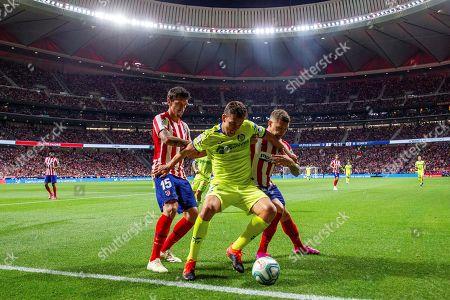Atletico Madrid's Stefan Savic (L) and Kieran Trippier vie for the ball with Getafe CF's Jaime Mata (C) during a LaLiga Santander first round match between Atletico Madrid and Getafe at the Wanda Metropolitano stadium, in Madrid, Spain, 18 August 2019.