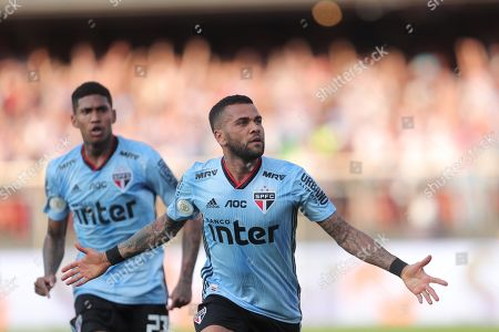 Stock Photo of Sao Paulo's Daniel Alves celebrates a goal during a Brazilian soccer league match between Sao Paulo and Ceara at the Morumbi stadium, in Sao Paulo, Brazil, 18 August 2019.