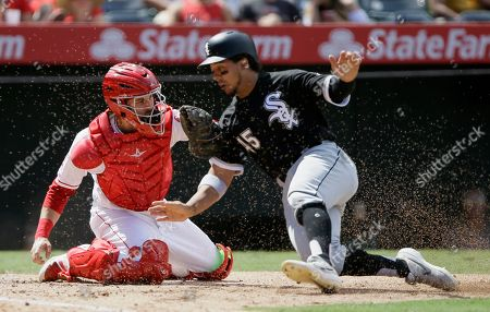 Los Angeles Angels catcher Anthony Bemboom, left, tags out Chicago White Sox' Jon Jay, trying to score on a single to center field by James McCann, during the sixth inning of a baseball game in Anaheim, Calif