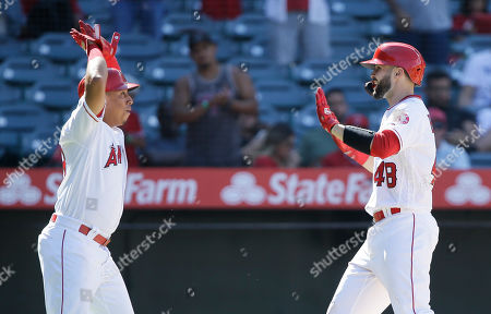 Los Angeles Angels' Wilfredo Tovar celebrates with Anthony Bemboom after Bemboom hit a two-run home run during the eighth inning of a baseball game against the Chicago White Sox in Anaheim, Calif
