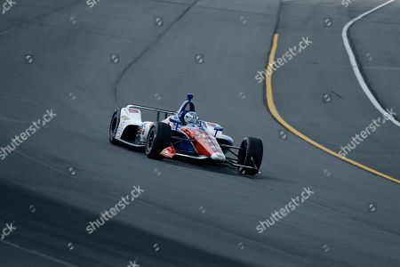 Tony Kanaan in action during the IndyCar Series auto race at Pocono Raceway, in Long Pond, Pa