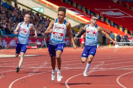 Stock Photo of Alexander Thomson, Thomas Young and Ross Paterson of Great Britain after crossing the finish line during the men's T35 / 38 100 metres