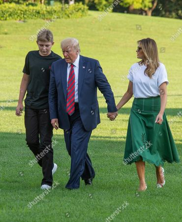 US President Donald Trump, Barron Trump and First Lady Melania Trump, return from their summer vacation to their New Jersey home and golf resort in Bedminster NJ. The Presidents son, Barron now towers over his father
