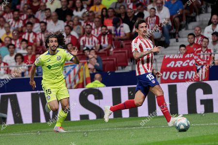 Stefan Savic of Atletico Madrid and Marc Cucurella of Getafe