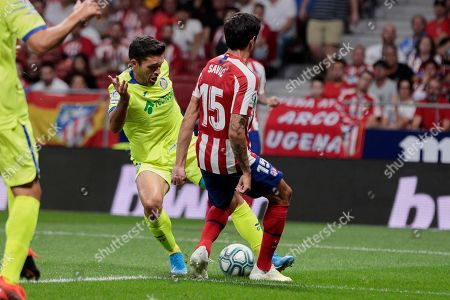 Jorge Molina of Getafe and Stefan Savic of Atletico Madrid