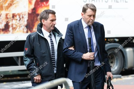 Lord Chris Holmes of Richmond (L) arrives at Southwark Crown Court in London today, accused of sexual assault. Nine-time Paralympic swimming champion, Holmes is accused of touching the alleged victim at a hotel in central London.