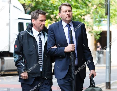 Stock Picture of Lord Chris Holmes of Richmond (L) arrives at Southwark Crown Court in London today, accused of sexual assault. Nine-time Paralympic swimming champion, Holmes is accused of touching the alleged victim at a hotel in central London.
