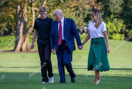Barron Trump, United States President Donald J. Trump and First Lady Melania Trump return to the White House following a stay in Bedminster, New Jersey