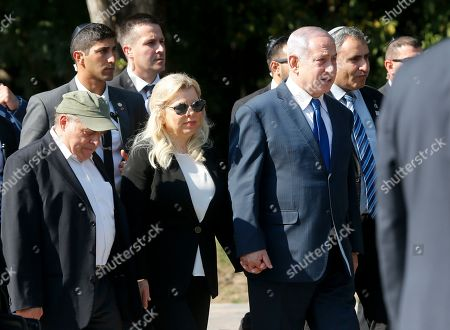 Israeli Prime Minister Benjamin Netanyahu, centre right, and wife Sara, walk to visit a monument in Babi Yar ravine where Nazi troops machine-gunned many thousands of Jews during WWII, in Kyiv, Ukraine,. Netanyahu said he plans to discuss ways to expand trade between Israel and Ukraine during the talks with Ukrainian President Volodymyr Zelensky