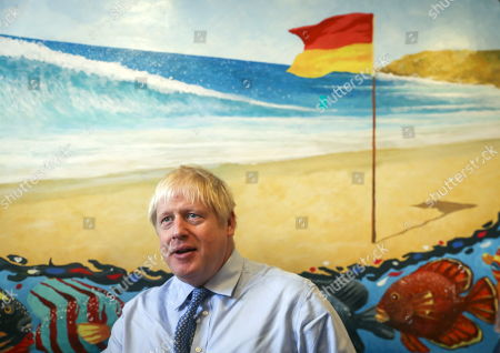 British Prime Minister Boris Johnson speaks to nurses during a visit to the Royal Cornwall Hospital in Truro, Britain, 19 August 2019. According to reports, Prime Minister Johnson will tell German Chancellor Angela Merkel and French President Emmanuel Macron this week the EU must offer an acceptable new deal or face Britain leaving without one. Labour leader Jeremy Corbyn on 19 August said that he will bring a no-confidence vote in government to stop No-deal Brexit.