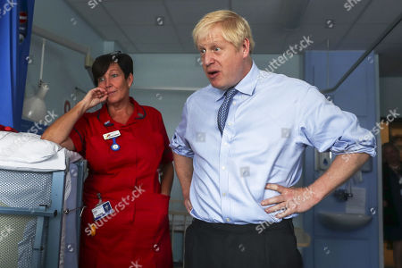 British Prime Minister Boris Johnson (R) meets with a patient during a visit to the Royal Cornwall Hospital in Truro, Britain, 19 August 2019. According to reports, Prime Minister Johnson will tell German Chancellor Angela Merkel and French President Emmanuel Macron this week the EU must offer an acceptable new deal or face Britain leaving without one. Labour leader Jeremy Corbyn on 19 August said that he will bring a no-confidence vote in government to stop No-deal Brexit.