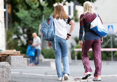 Norway's Princess Ingrid Alexandra (L) is accompanied by her mother, Crown Princess Mette-Marit (R), as she arrives at the Uranienborg School in Oslo, 19 August, 2019. It will be reportedly the last year the 15-years old Princess will spend on the public junior high school.