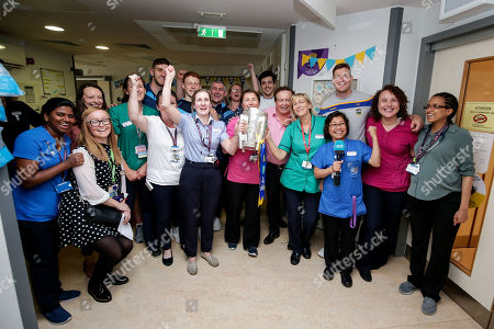 Staff of the St. John's Ward with RTE's Marty Morrissey and members of the Tipperary team