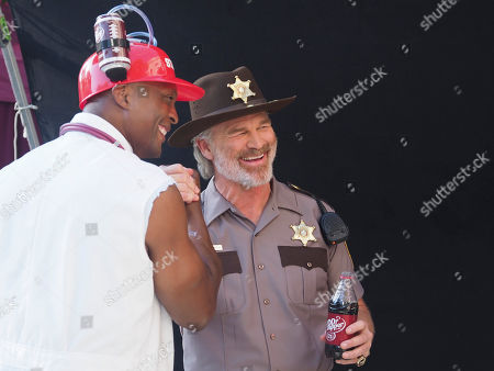 IMAGE DISTRIBUTED FOR FOR DR PEPPER - College football legends Brian Bosworth and Eddie George film a scene from the upcoming season of Fansville ? the parody TV drama from Dr Pepper ? at the Universal Studios Backlot. Fansville Season 2 premieres on