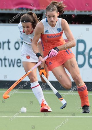 Netherland's Lidewij Welten, right, vies for the ball against Spain's Lucia Jimenez during a women's European Championships field hockey match between Spain and the Netherlands at the Wilrijkse Plein, Antwerp, Belgium