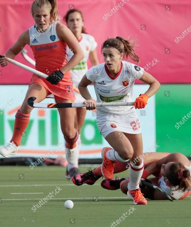 Spain's Lucia Jimenez, center, runs for the ball during a women's European Championships field hockey match between Spain and the Netherlands at the Wilrijkse Plein, Antwerp, Belgium