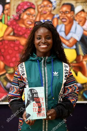 Eniola Aluko with her autobiography 'They Don't Teach This' at Bonhams, London. The Nigerian/British footballer is a huge advocate for contemporary African art, and she is pictured amongst artworks from the Bonhams African Art department.