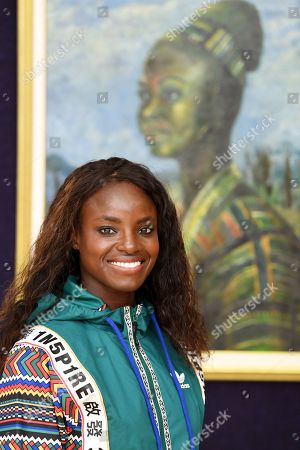 Eniola Aluko at Bonhams, London. The Nigerian/British footballer is a huge advocate for contemporary African art, and she is pictured amongst artworks from the Bonhams African Art department.