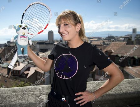 Swiss tennis player Timea Bacsinszky (R), silver medalist winner at the Rio 2016 Olympic Games women's tennis doubles, poses with Yodli, the official mascot for the next Winter Youth Olympic Games Lausanne 2020, YOG, at the Olympic Museum, in Lausanne, Switzerland, 19 August 2019. The 2020 Winter Youth Olympic Games, YOG, will take place in Lausanne from 10 to 19 January 2020.