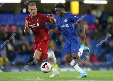 Stock Image of Tariq Lamptey of Chelsea races upfield as Liverpool's Herbie Kane looks on during Chelsea Under-23 vs Liverpool Under-23, Premier League 2 Football at Stamford Bridge on 19th August 2019