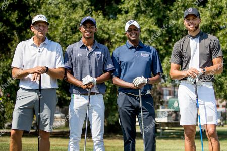 From left, Callaway Golf Company CEO Oliver Brewer III, Howard student Otis Ferguson, Howard University President Wayne Frederick, and Basketball guard Stephen Curry, pose for photographs before teeing off together at Langston Golf Course in Washington, following a news conference where Curry announced that he would be sponsoring the creation of men's and women's golf teams at Howard University
