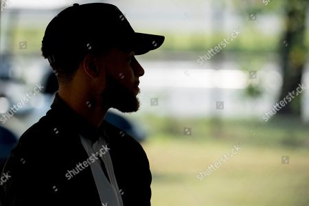 Golden State Warriors guard Stephen Curry attends a news conference at Langston Golf Course in Washington, where Curry announced that he would be sponsoring the creation of men's and women's golf teams at Howard University