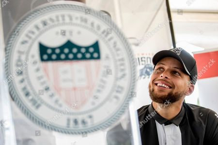 Stock Photo of Golden State Warriors guard Stephen Curry attends a news conference at Langston Golf Course in Washington, where Curry announced that he would be sponsoring the creation of men's and women's golf teams at Howard University