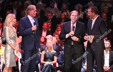 Stock Picture of Sports journalist Gerhard Delling (2-L) and former soccer player Guenter Netzer (2-R) are granted the 'Best TV Duo ever' award by Sportbild editor-in-chief Matthias Bruegelmann (R) and presenter Andrea Kaider (L) at the Sportbild Award in Hamburg, Germany, 19 August 2019. The newspaper's award is granted to athletes since 2003.