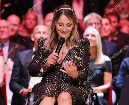 Stock Photo of Former German cyclist Kristina Vogel is granted the 'Hero of the Year' award at the Sportbild Award in Hamburg, Germany, 19 August 2019. The newspaper's award is granted to athletes since 2003.