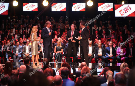 Sports journalist Gerhard Delling (2-L) and former soccer player Guenter Netzer (2-R) are granted the 'Best TV Duo ever' award by Sportbild editor-in-chief Matthias Bruegelmann (R) and presenter Andrea Kaider (L) at the Sportbild Award in Hamburg, Germany, 19 August 2019. The newspaper's award is granted to athletes since 2003.