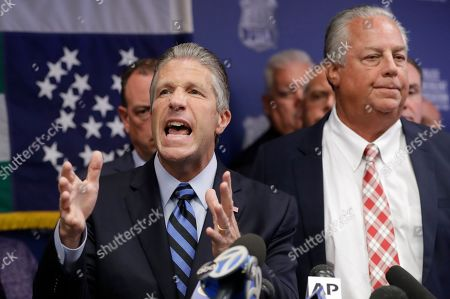 Patrick Lynch, Stuart London. Police Benevolent Associaton President Patrick J. Lynch, left, speaks with NYPD officer Daniel Pantaleo's attorney Stuart London beside him, right, during a press conference at PBA headquarters following a decision to terminate Pantaleo, in New York. Pantaleo was involved in the chokehold death of Eric Garner. T