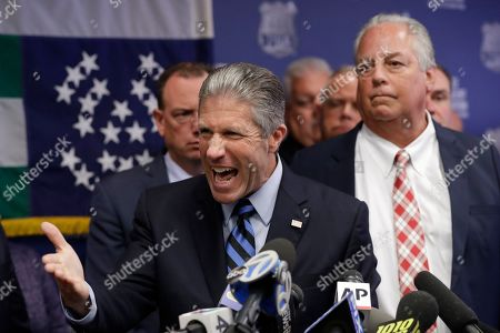 Stock Image of Patrick Lynch, Stuart London. Police Benevolent Associaton President Patrick J. Lynch, left, speaks with NYPD officer Daniel Pantaleo's attorney Stuart London by his side, right, during a press conference at PBA headquarters following a decision to terminate Pantaleo, in New York. Pantaleo was involved in the chokehold death of Eric Garner