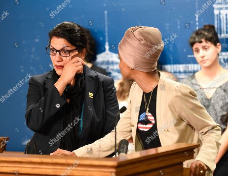 Democratic Representative from Michigan Rashida Tlaib (L) wipes away a tear while she became emotional talking about her family as Democratic Representative from Minnesota Ilhan Omar (R) looks on during a news conference at the Minnesota state capitol in St. Paul, Minnesota, USA, 19 August 2019.