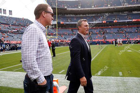 Former Denver Broncos quarterback Peyton Manning, left, and San Francisco 49ers general manager John Lynch watch prior to an NFL preseason football game, in Denver
