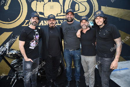 Rene Hagege, owner of Heroes Motors, center, Emilio Rivera, Michael Irby, Richard Cabral and Danny Pino of FX's Mayans M.C. attends the Season 1 DVD release celebration at Heroes Motors. Mayans M.C. Season 1 in stores