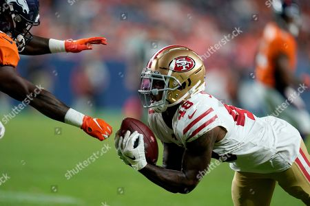 San Francisco 49ers defensive back Dontae Johnson (48) intercepts a pass intended for running back Dave Williams, left, during the second half of an NFL preseason football game, in Denver