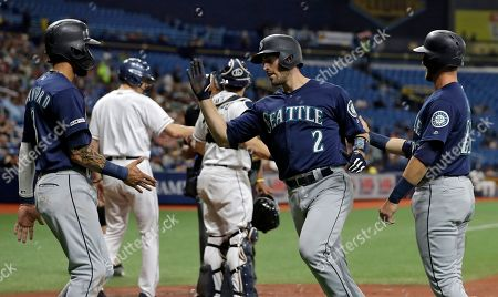 Tom Murphy, J.P. Crawford, Austin Nola. Seattle Mariners' Tom Murphy (2) celebrates with J.P. Crawford (3) and Austin Nola (23) after Murphy hit a three-run home run off Tampa Bay Rays starting pitcher Brendan McKay during the first inning of a baseball game, in St. Petersburg, Fla