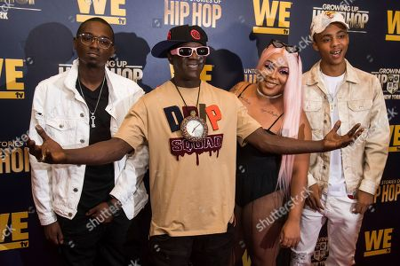 """Stock Picture of Flavor Flav, Dazyna Drayton, William Draymond Jr., H2Flee. William Drayton Jr., left, Flavor Flav, Dazyna Drayton and H2Flee attend the premieres of We TV's """"Growing Up Hip Hop: New York"""" and """"Untold Stories of Hip Hop"""" at The Paley Center, in New York"""