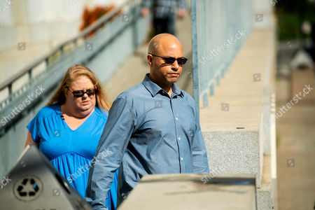 David Gregory, who's daughter Michela Gregory died in the 2016 Ghost Ship warehouse fire, leaves Alameda County Superior Court, in Oakland, Calif. At left is Karen Bourdon Frieholtz. Three jurors were dismissed Monday for undisclosed reasons on the 10th day of deliberations in the trial of two men charged in the deaths of 36 partygoers from a fire inside a cluttered San Francisco Bay Area warehouse