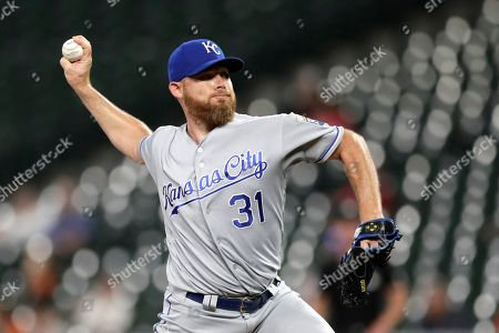 Kansas City Royals relief pitcher Ian Kennedy throws a pitch to a Baltimore Orioles batter during the ninth inning of a baseball game, in Baltimore. The Royals won 5-4