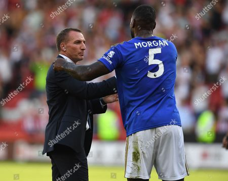 Brendan Rodgers manager of Leicester City celebrates with Wes Morgan at full time