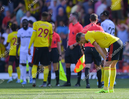 Craig Cathcart of Watford dejected at the final whistle