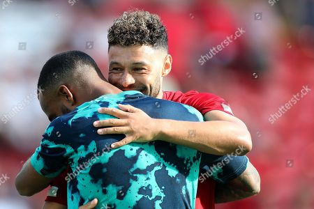 Alex Oxlade-Chamberlain of Liverpool hugs Alexandre Lacazette of Arsenal during the pre-match warm-up