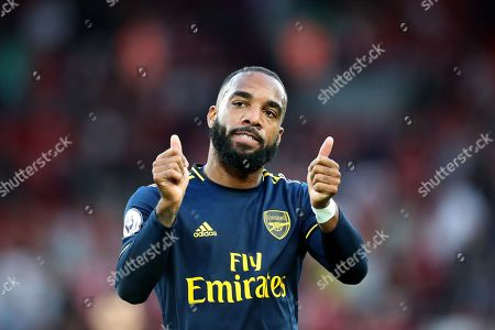 Alexandre Lacazette of Arsenal gives the fans a thumbs up at the end of the match