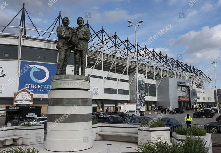 The front of the stadium with the Peter Taylor and Brian Clough statue in the foreground