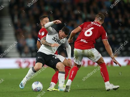 Stock Photo of Derby County's Jack Marriott tussles with Bristol City's Josh Brownhill and  Nathan Baker