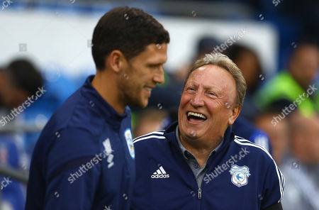 Cardiff City manager Neil Warnock shares a joke with Huddersfield Town caretaker manager Mark Hudson