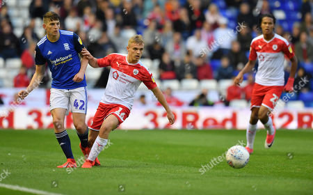Barnsley's Luke Thomas watches the ball from Birmingham's Steve Seddon.